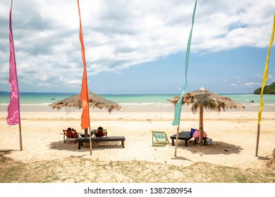 Parasol and deck chair beautiful sea and color flags at Ao Kao beach, Koh Mak island, Trat, Thailand