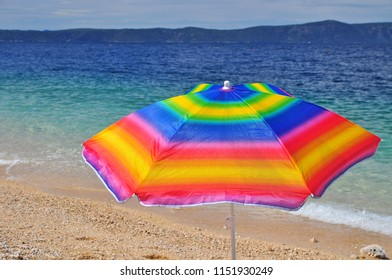 Parasol on summer beach by sea vacation