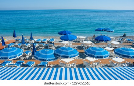 Parasols and deckchairs on the beach of the city of Nice in the south of France