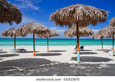 parasols on beach in varadero, cuba