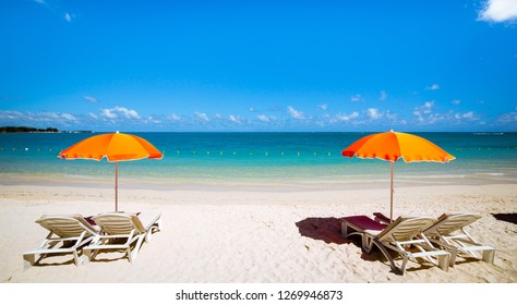 Parasols and sand beach in Mauritius island
