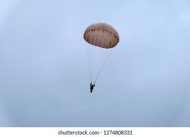 Paratrooper is landing