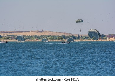 Paratrooper recovery over a lake