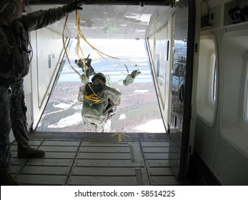 Paratroopers jumping from an airplane, Alaska