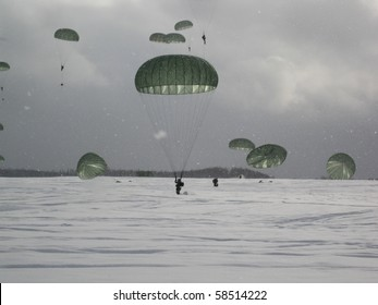 Paratroopers landing on a drop zone in January, Alaska