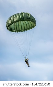 Paratroopers reenacting a jump from a world war 2 (ww2) Dakota airplane during Operation Market Garden in Holland/the Netherlands. During the 75 year commemoration at 17th september 2019, Schijndel.