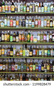 PARATY, BRAZIL - OCTOBER 14, 2014: Cachaca alcohol bottles collection in Brazil. Cachaca is a distilled spirit made of sugarcane juice, traditional for Brazil.