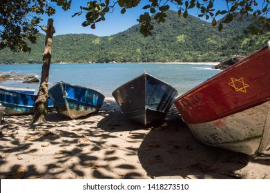 Paraty/Rio de Janeiro/Brazil - August 04th 2014: Boats in Middle Beach, Trindade, near Paraty, a National Historic Landmark by IPHAN (National Historic and Artistic Heritage Institute)