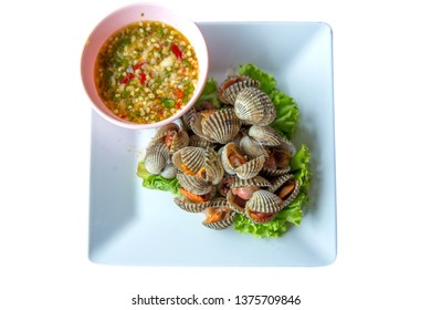 Parboiled fresh cockles in the dish scald cockles with seafood sauce, die cut white isolated
