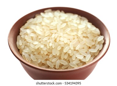 Parboiled long grain rice in cup closeup