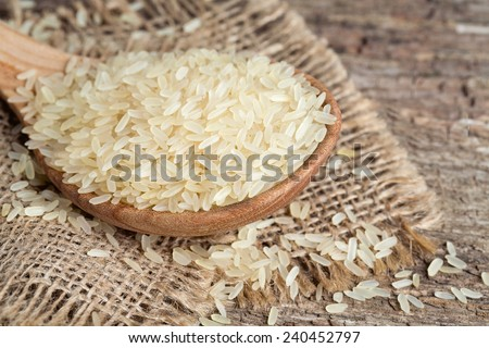 parboiled rice on wooden surface