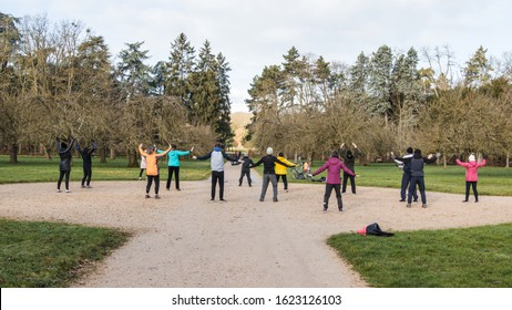 Parc de Sceaux, France, 19 January 2020. A group of people practicing qigong in a park