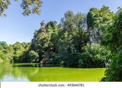 Parc des Buttes-Chaumont - Public Park situated in northeastern Paris. It was opened in 1867; it is fifth-largest park in Paris. Most famous feature of park is Temple de la Sibylle (1867). France.