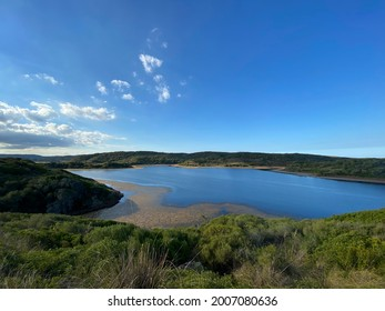 Parc Natural de S´  Albufera des Grau, Illes Balears, Menorca, Spain. Clouds and sky reflected in the waters of the coastal lagoon inside Es Grau Natural Park.
