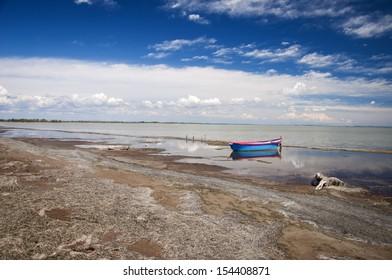 Parc Regional de Camargue, Provence, France. A singe boat with camargue horizon.