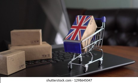 Parcel Boxes with a flag of United Kingdom in a shopping cart