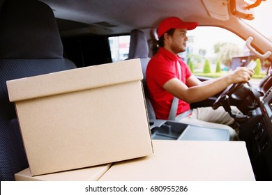 parcel delivery man drive a car smiling  transport postal delivery courier delivering package. delivered to customers Impressive service.