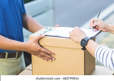 parcel delivery of a package through a service Customer and Pick up autograph sign. hand accepting a delivery of boxes from delivery man. All services are impressive.