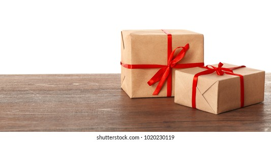 Gift wrapped images stock photos vectors shutterstock parcel gift boxes on wooden table against white background negle Image collections