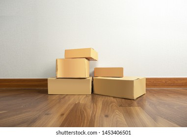Parcel packaging boxes on home floor
