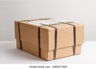 Parcel with strapping on a white table