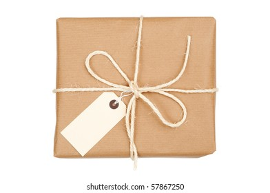 Parcel tied with string with label attached on white background