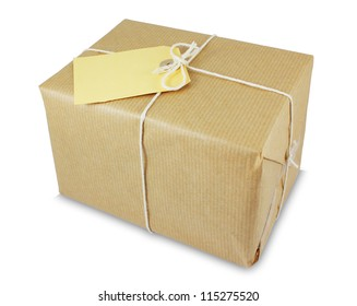 Parcel wrapped in brown paper with string and an empty label