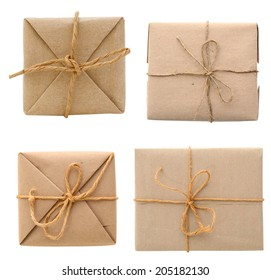 Parcel wrapped in brown paper and tied with rough twine, above view