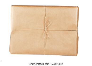A parcel wrapped in brown paper and tied with rough twine, isolated on white background. Shallow depth of field