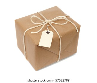 Parcel wrapped with brown paper, tied with string and with blank label