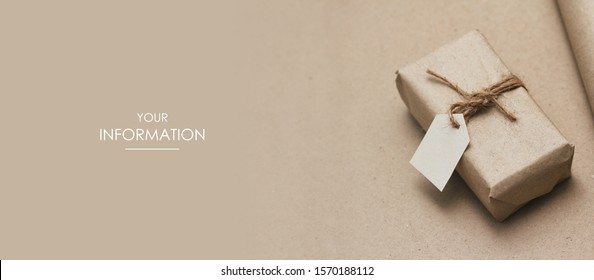 Parcel wrapped in craft paper and tie hemp cord. Name and destination label. Worldwide shipping. Online shopping. Brown background. Web article template. Long header banner format. Sale coupon.