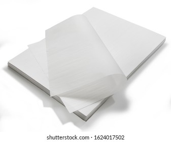 Parchment paper baking sheets stack, isolated on white background