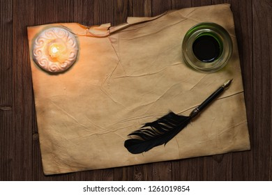 parchment paper with quil pen and ink lit by candle