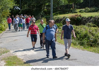 PAREDES DE COURA, PORTUGAL - JULY 25, 2017: Group of people hiking in the nature at Paredes de Coura