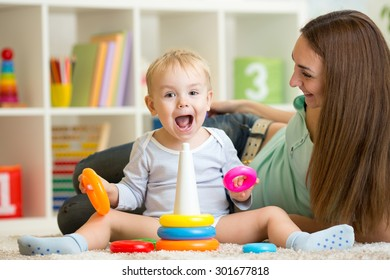 parent and child boy play together at home