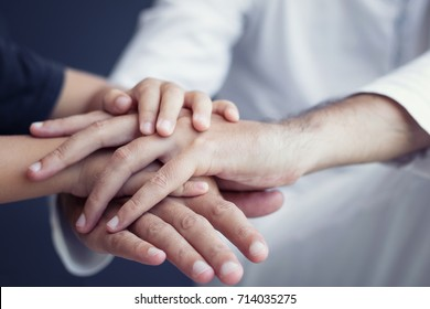 Parent and child holding hands and supporting each other. Son and father holding hands in unity.