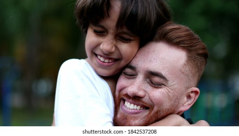 Parent and child hugging and embrace. Father and young boy ethnic diverse love and care, authentic