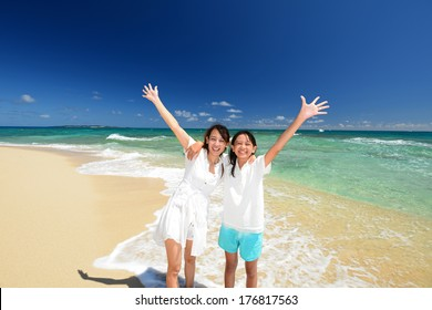 Parent and child playing at the beach