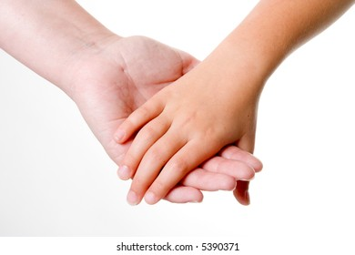 Parent holding the hand of a child