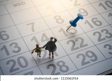 Parent and kid going to school with pinned calendar.