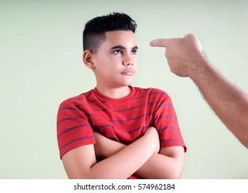 Parent scolds his disobedient son