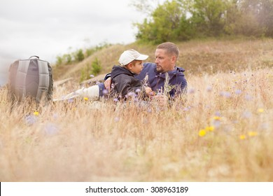 parent talking child nature lying grass  meadow field shallow DOF
