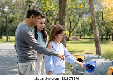 parent teach to children to throw empty plastic bottle into the garbage