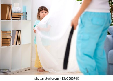 Parental punishment. Child abuse. Mom punish a little daughter with a belt and puts her in a corner. Don't hit the kids, help to protect children