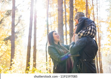 Parenthood, fall and people concept - young family happy in autumn park