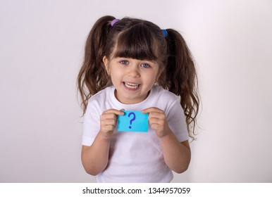Parenting difficult child. Little girl holding sticker with question.