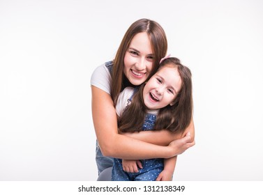 Parenting, family and children concept - A portrait of a mother and her baby girl have fun and smiling over white background
