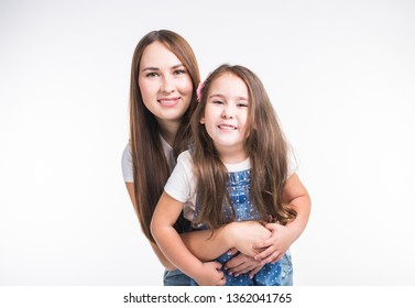 Parenting, family and children concept - Portrait of a mother and her baby girl have fun and smiling over white background