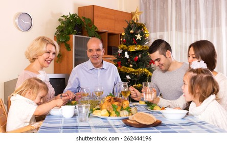 parents with adult kids and grandchildren celebrating New Year tonight