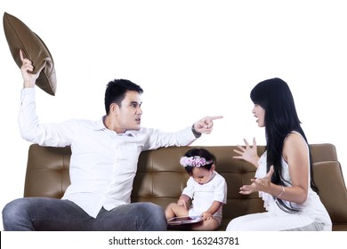Parents arguing in front of their daughter isolated on white